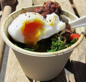 Poached duck egg on lamb bowl