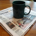 Mug of bone broth and newspaper
